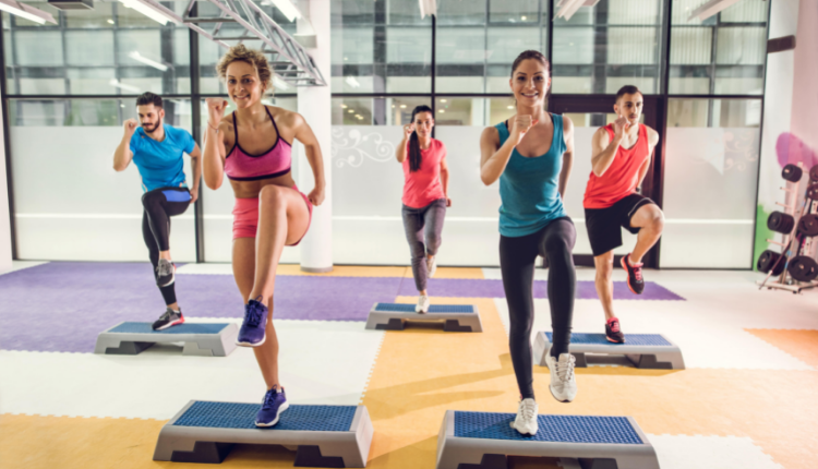Ladies in brightly coloured gym wear on exercise steps