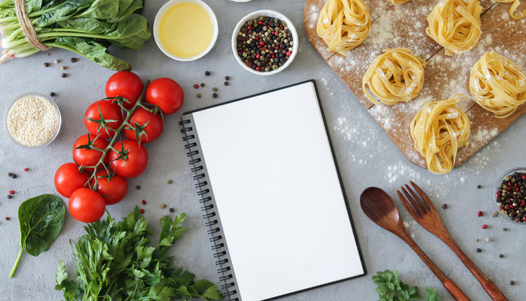 fresh ingredients and a note book on a worktop