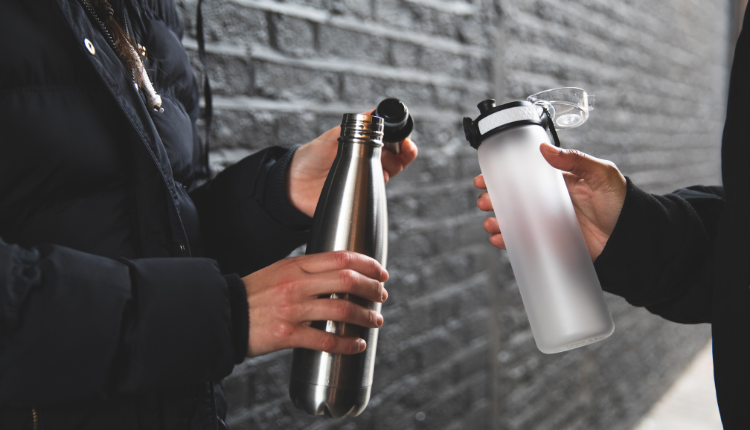 A metal water bottle and a glass water bottle