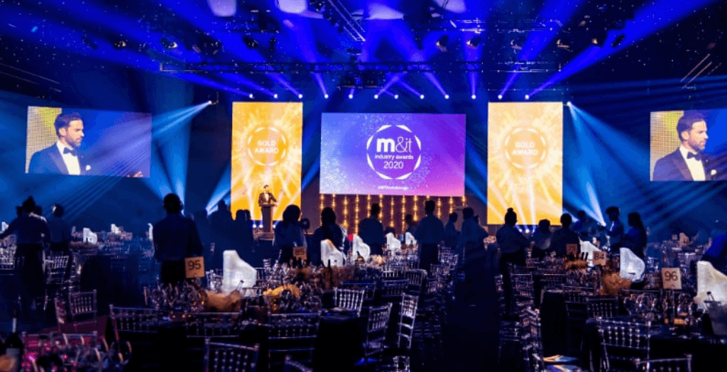 An awards ceremony with lasers and dressed tables